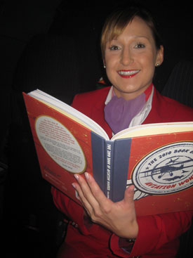 Laura, a Virgin Atlantic flight attendant, reads The 2010 Book of Aviation Wonder which was specially published for BAC 100.