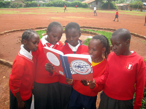 Pupils at Desai Memorial Primary School, Kawangware, Kenya are enjoying the book. The photo was taken by Virgin Atlantic pilot Bob Ilett who regularly visits the school to bring donations of books, clothes, sports equipment and stationery.