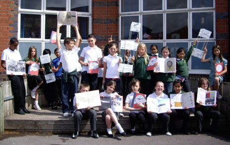 In this photo the pupils are holding up copies of their books and also some of the boxkites they have made for a special event to mark the centenary of the first flight of the Bristol Boxkite aeroplane. Bill Morgan, who has helped them make the boxkites, was at the special school assembly on 2 July.