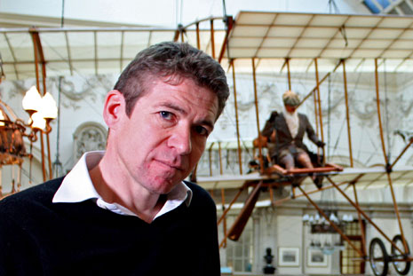 Saul David with the replica Boxkite in Bristol's City Museum and Art Gallery.